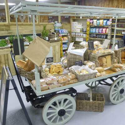 Farm Shop display cart with fresh bread and cakes