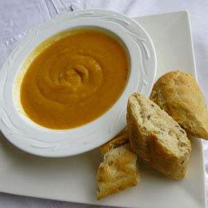 Homemade soup served with freshly baked bread